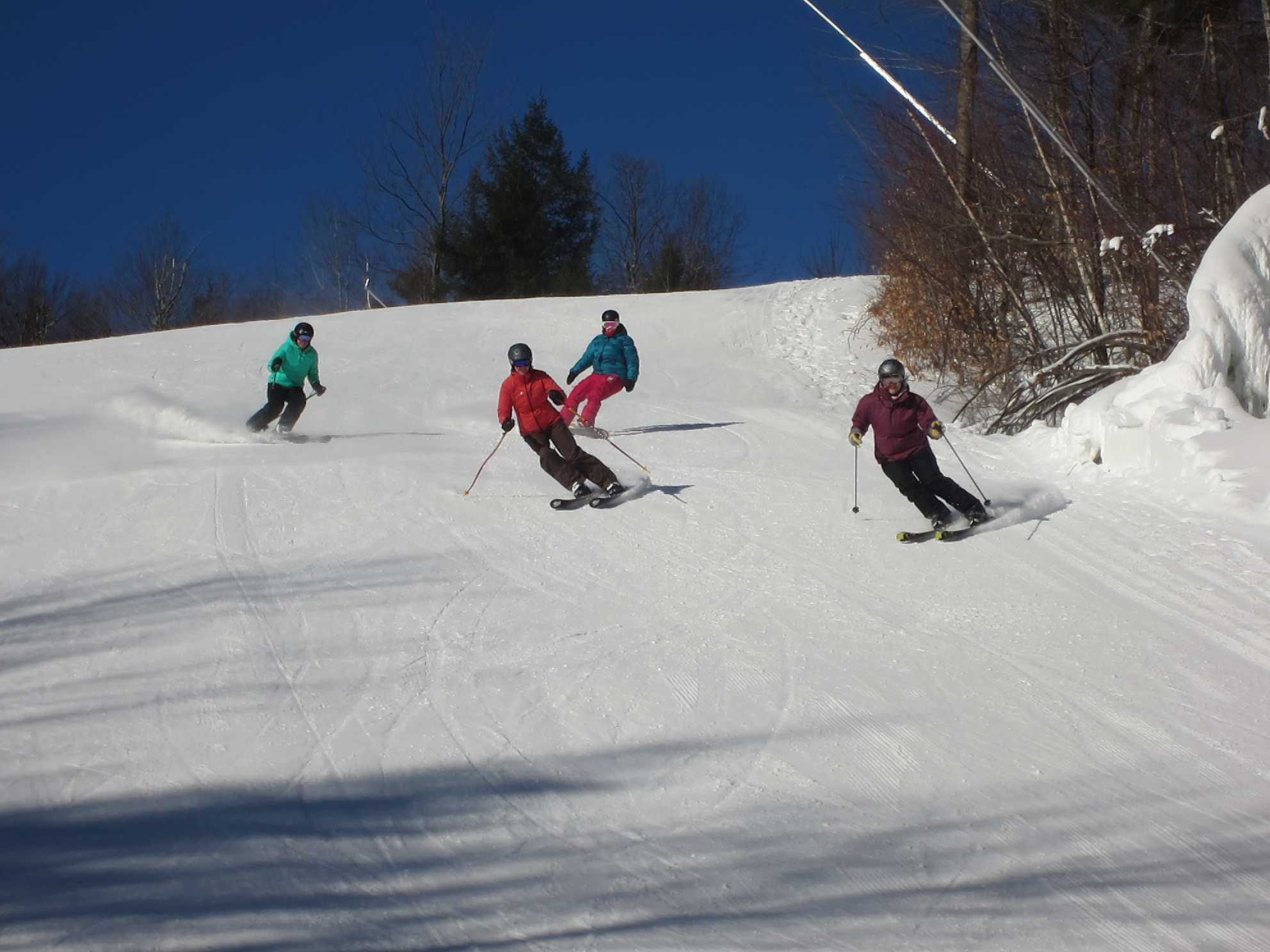 Sarah (far right) skiing in weekly video shoot.